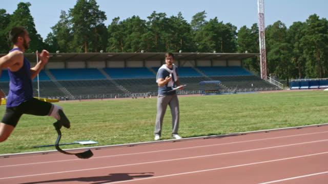 Amputee athlete sprinting on track