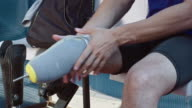 Amputee runner putting on prosthetic leg