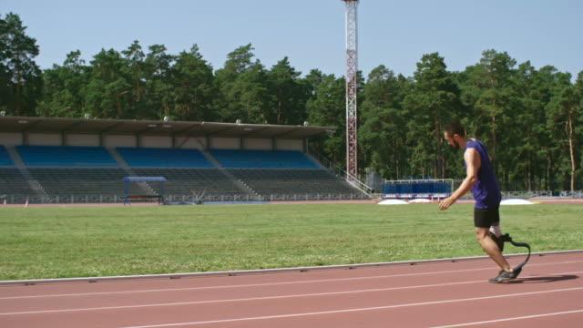 Amputee runner warming up at stadium