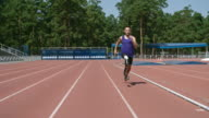 Amputee sprinter running in slow motion