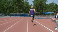 Amputee sprinter training for Paralympics