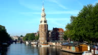 Amsterdam Skyline with Canal and old Tower