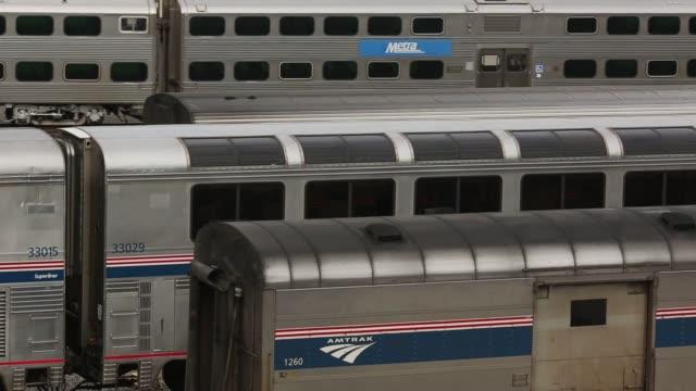 Amtrak trains travel through Chicago Illinois US on Wednesday October 7 2015 Shots Close up shots of Amtrak trains rolling through a train yard...