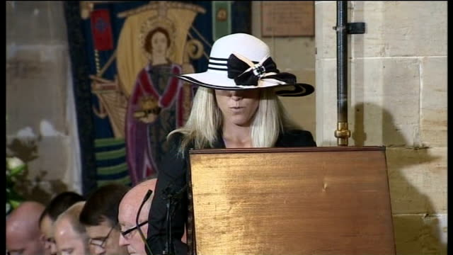 INT Amy Carlson reading out poem at funeral service SOT Coffin in church Congregation Dennis Goodwin speaking at funeral service
