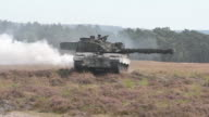 US amy soldiers and tanks carrying out training exercises in Poland