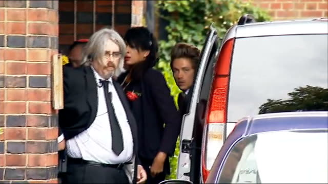 Golders Green Crematorium ENGLAND London Golders Green EXT People arriving at Golders Green Crematorium for the funeral of singer Amy Winehouse...