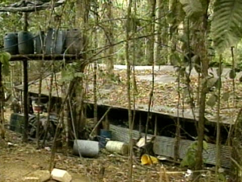 An abandoned cocaine factory discovered by Colombian soldiers in the jungle Colombia 1990s
