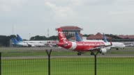 An AirAsia Bhd aircraft taxis on the runway at Soekarno Hatta International Airport in Cengkareng near Jakarta Indonesia on Monday Dec 29 An AirAsia...
