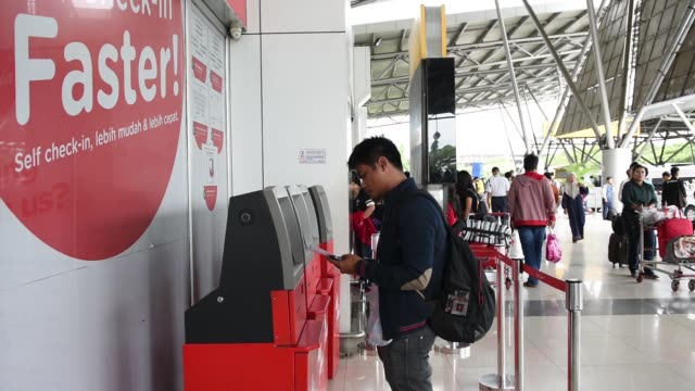 An AirAsia logo sits on a sign in the departure hall at Soekarno Hatta International Airport in Cengkareng near Jakarta Indonesia on Monday Dec 29...