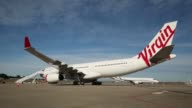 An Airbus SAS A330 aircraft operated by Virgin Australia Holdings Ltd stands at Sydney Airport in Sydney Australia on Monday Aug 17 2015 Shots Wide...