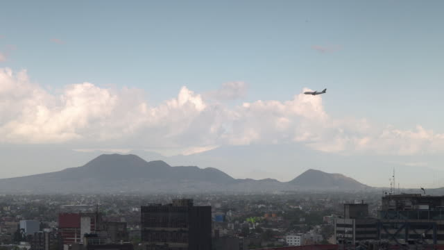 An airplane flies over Mexico City