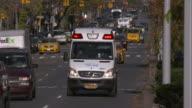 An Ambulance drives up a manhattan street (Slow Motion)