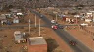 An ambulance moves through a suburb of Soweto, South Africa.