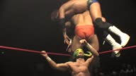 An American style professional wrestling match sequence featuring a high impact 3 man top rope suplex