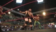 An American style professional wrestling match sequence featuring a masked Mexican Luchador