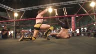 An American style professional wrestling match sequence featuring an impressive backflip slam