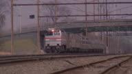 An Amtrak train travels on train tracks.