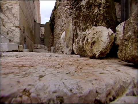 An ancient cobblestone path leads in between two walls at the Temple Mount ruins.