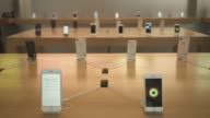 An Apple Inc iPhone 8 Plus left and iPhone 8 stand on display at the Apple Store at Sanlitun during the launch of the devices in Beijing China on...