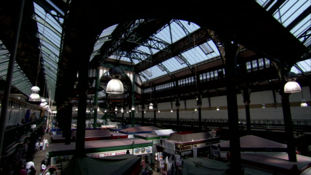 An arched passageway covers the Kirkgate Market in Leeds, England. Available in HD.
