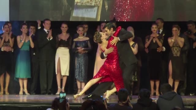 An Argentine couple wins first place at the Tango Salon competition during the 15th Tango Dance World Championship in Buenos Aires where local...