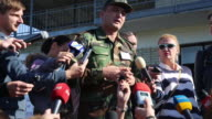 An army major from Azerbaijan describes to a large group of Ukrainian and international media a combat training scenario to take place in a few...
