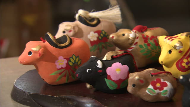 An array of clay bells represent the ox zodiac sign.
