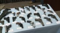 An Array of Illegal Assault Rifles Confiscated By the New York City Police Department at a Press Conference Right to Left Pan of Confiscated Assault...