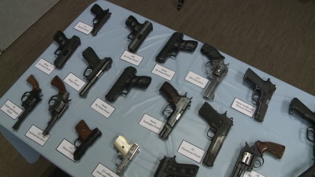 An Array of Illegal Assault Rifles Confiscated By the New York City Police Department at a Press Conference Left to Right Pan of Confiscated Assault...