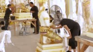 An artist paints on a decorative item for the cremation ceremony of King Bhumibol Adulyadej in a studio at the Fine Arts Department in Bangkok...