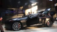 An Aston Martin V12 Vantage S sports car sits on display at the Paris Motor Show on the final preview day in Paris France on Friday Oct 3 Visitors...
