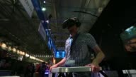 An attendee wears an Oculus VR Inc virtual reality headset at the Gamescom video games trade fair in Cologne Germany on Wednesday Aug 5 2015 Shots A...