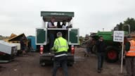 An auctioneer stands in a mobile auction van as he takes bids for construction equipment at the Cheffins Cambridge Machinery Sales monthly machinery...