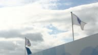 An automobile passes a GE logo outside the General Electric Co chalet on the first day of the Farnborough International Airshow in Farnborough UK on...