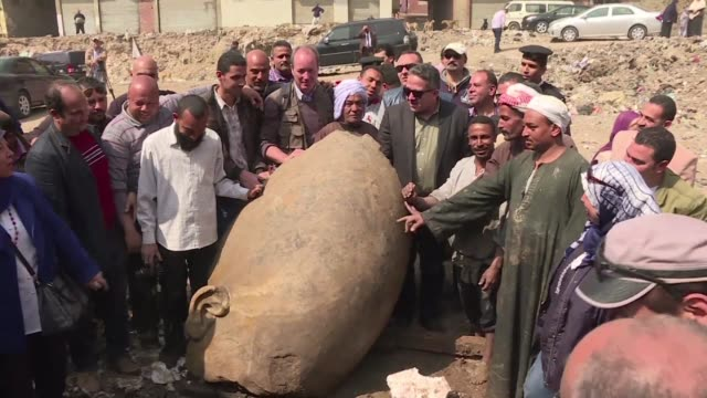 An Egyptian German team of archaeologists found Thursday an eight meter statue submerged in ground water in a Cairo suburb that they say probably...