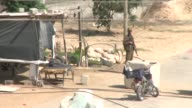 An Egyptian soldier was killed early Friday in attacks by Islamist militants on army checkpoints and a police base in the the border town of Rafah in...