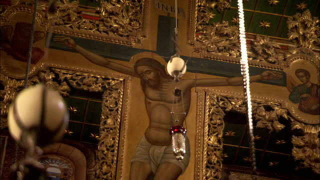 An elaborate gilded crucifix hangs from the Basilica ceiling in Saint Catherine's Monastery. Available in HD.
