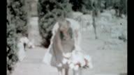 An elderly woman visits a cemetery