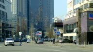 An electronic advertising sign hangs on a building wall in Kiev Ukraine on Sunday March 23 General views city streets traffic Parus business center...