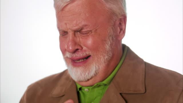 An emotional and sad elderly Scandinavian man Sweden.