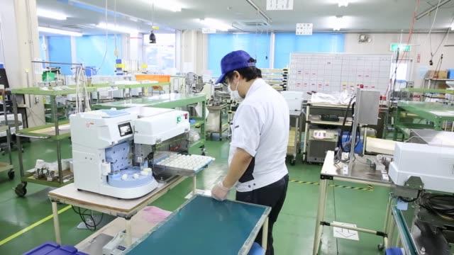 An employee assembles a compact sushimaking machine at the Suzumo Machinery Co factory in Kawashima Saitama Japan on Monday Aug 7 An employee...