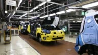 An employee assembles a Kia Motors Corp Soul vehicle on the production line at the company's plant in Gwangju South Korea on Friday July 8 Employees...