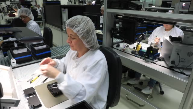 An employee checks and cleans a 24megapixel sensor during assembly of Leica M10 rangefinder digital camera at the Leica Camera AG factory in Wetzlar...