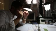 An employee checks the quality of a rough diamond at the MSD polishing laboratory in the diamond district of Antwerp Belgium on Thursday July 20 2017