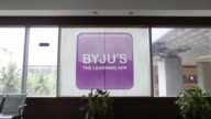 An employee enters the Thinkand Learn Pvt office in Bengaluru India on Wednesday April 5 Signage for BYJU'S learning app is displayed at the...