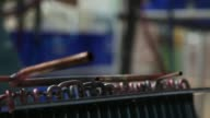 An employee manually brazes formed copper piping to a condenser at the Carrier Midea Pvt manufacturing facility in Bawal Haryana India on Tuesday May...