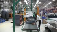 An employee moves air conditioner component parts at the Carrier Midea Pvt manufacturing facility in Bawal Haryana India on Tuesday May 27 Copper...