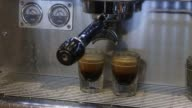 An employee operates an espresso machine at a Caffebene Co store in Ulaanbaatar Mongolia on Saturday Aug 12 An employee pours hot water from a...