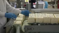 An employee packages slices of Roquefort Societe 150years cheese in the packaging line at the LebrouRoquefort plant part of Groupe Lactalis in...