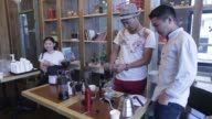 An employee second left teaches a coffeemaking course to customers at a Caffebene Co store in Ulaanbaatar Mongolia on Saturday Aug 12 Coffee is...